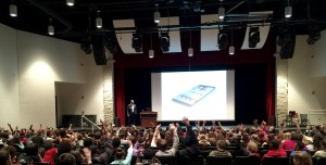 Speaking in auditorium at Lincoln High School
